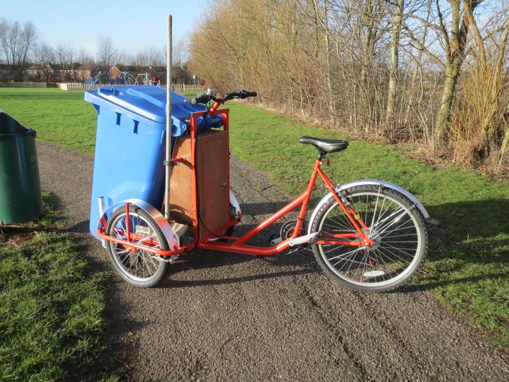 The trash trike can carry a 140 or 240 standard wheelie bin, plus tools.