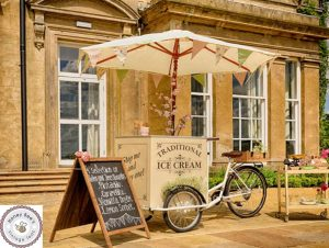 "Ice cream tricycle with standard cream parasol, ""stop me and buy one"" graphics and 'A' menu board"